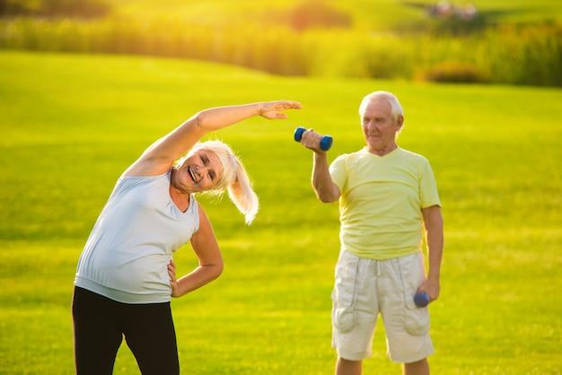 Senior couple does exercises