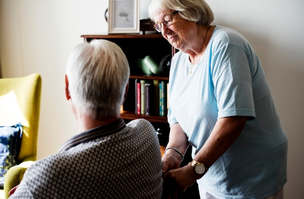 Senior couple, elderly woman taking care of an elderly man