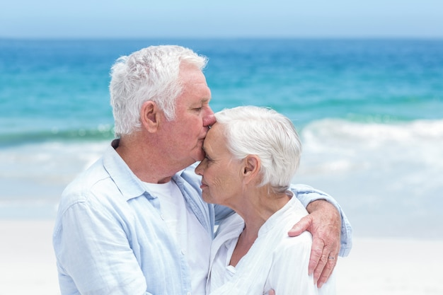 Senior couple embracing and kissing