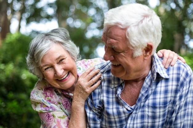 Senior couple enjoying in back yard