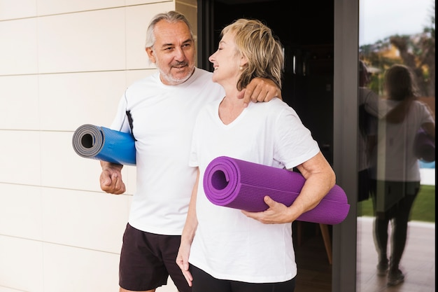 Senior couple excising in garden