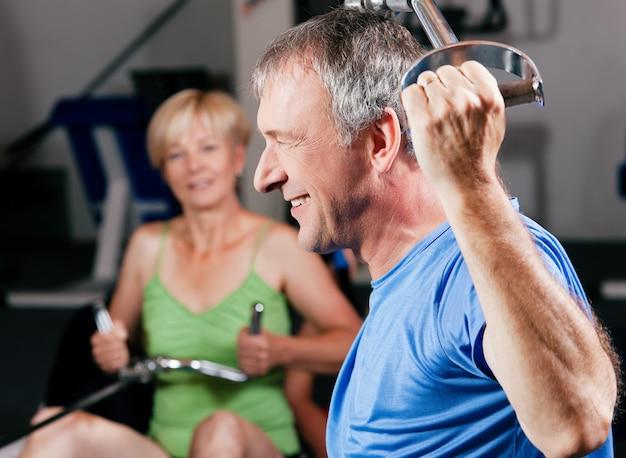 Senior couple exercising at gym