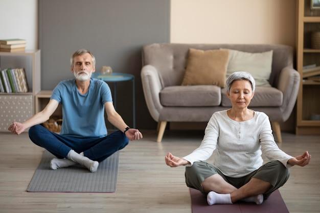 Senior couple exercising together at home