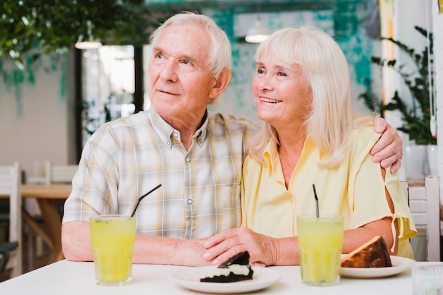 Senior couple having meal on outdoors terrace