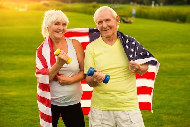 Senior couple holding dumbbells