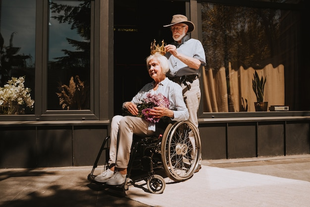 Senior couple at home partner coming back from hospital in convalescence