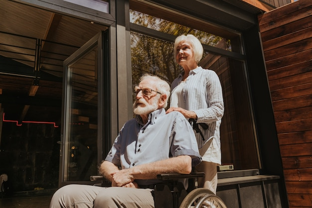 Senior couple at home partner coming back from hospital