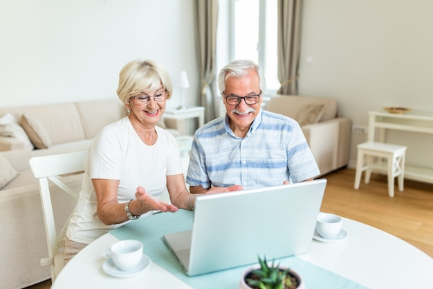 Senior couple is talking online via video connection on the laptop