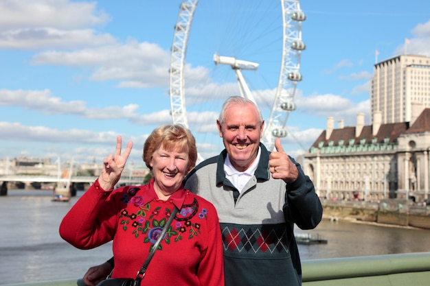 Senior couple in london with millenium wheel