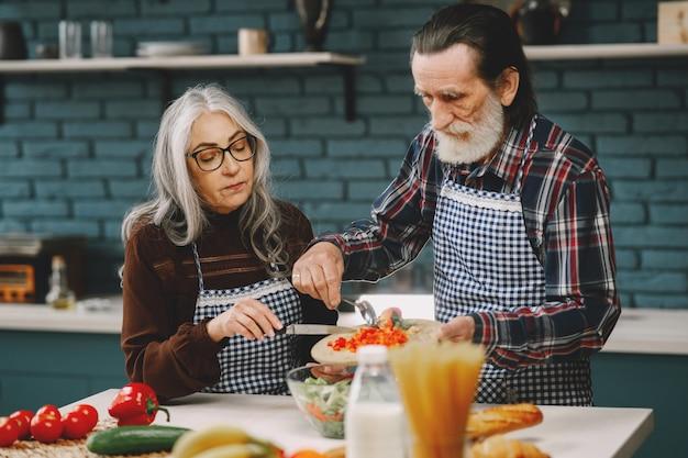 Senior couple preparing food in the kitchen