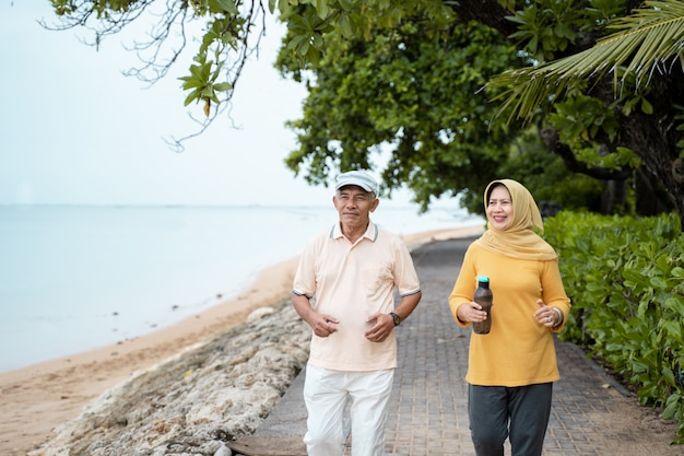Senior couple running and exercising outdoors