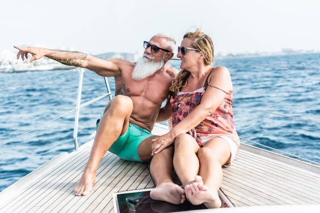 Senior couple on sailboat during luxury ocean trip vacation