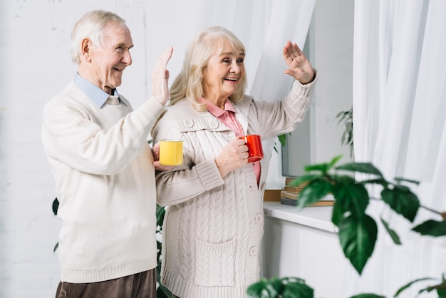 Senior couple saying hello