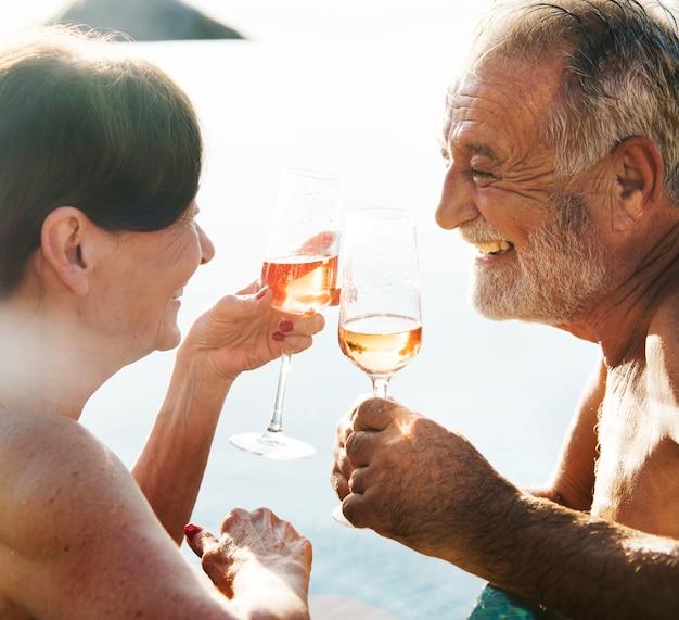A senior couple toasting