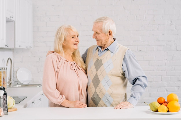 Senior couple together in kitchen