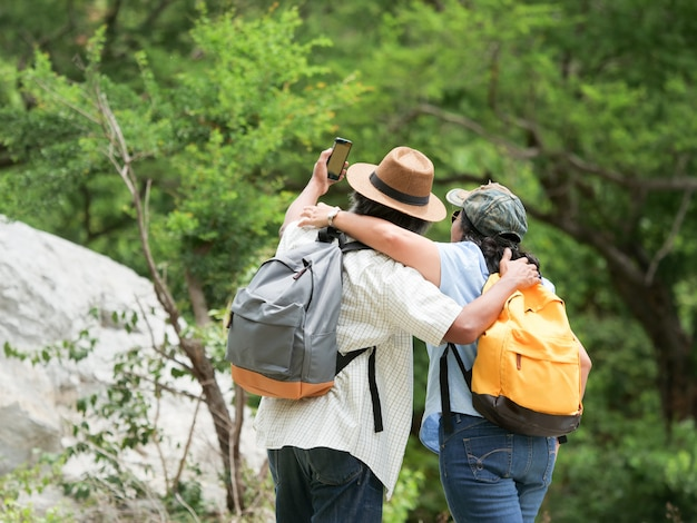 Senior couple travel together on a summer vacation.