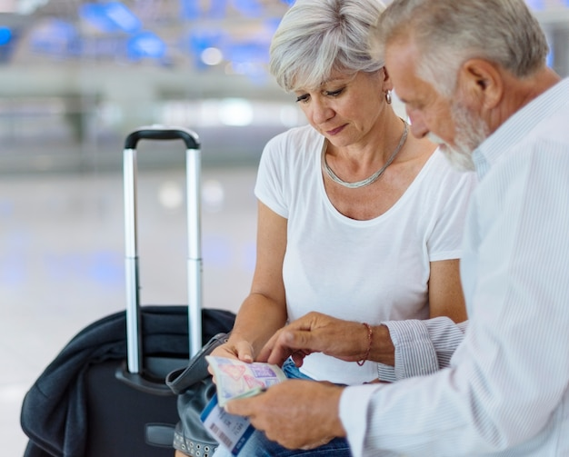 Senior couple traveling airport scene