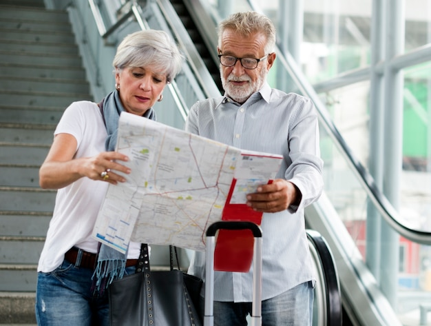 Senior couple traveling around the city