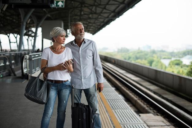Senior couple traveling train station