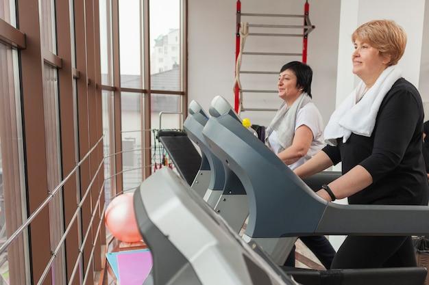 Senior couple on treadmill
