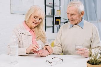 Senior couple using pills