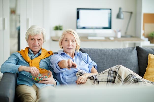 Senior couple watching television