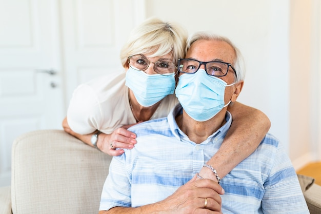 Senior couple wearing medical face mask and recovery from the illness at the home