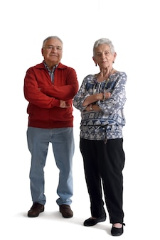 Senior couple with arms crossed on white