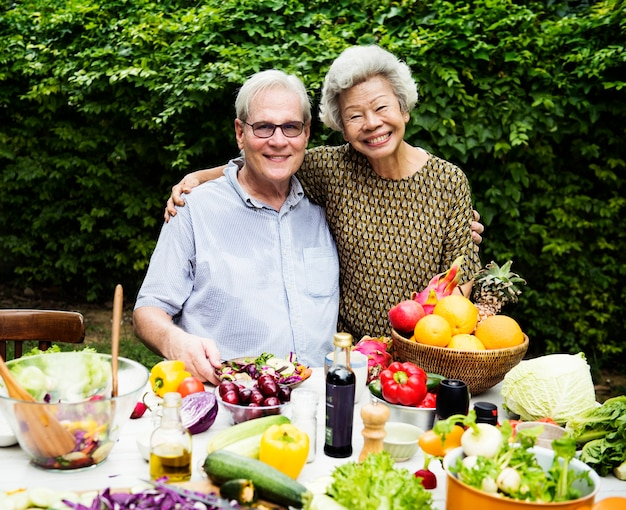 Senior couple with fresh vegetable outdoors