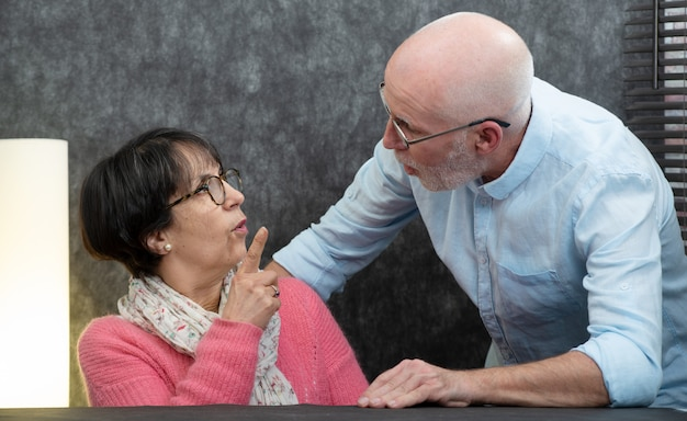 Senior couple with problems at home, woman angry