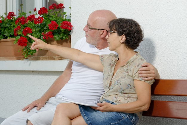 Senior couple with a tablet, outdoor