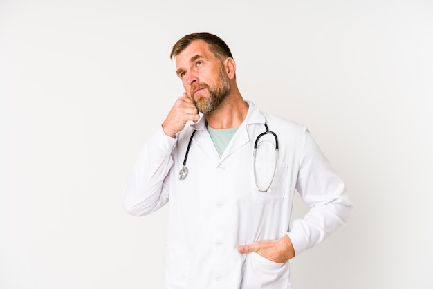 Senior doctor man isolated on white wall showing a mobile phone call gesture with fingers.
