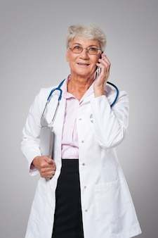 Senior doctor using from new technology