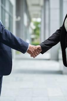 Senior entrepreneurs confirming deal