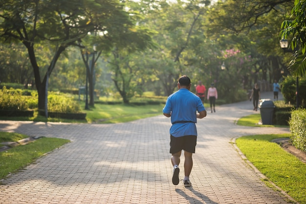 Senior fat man run in park