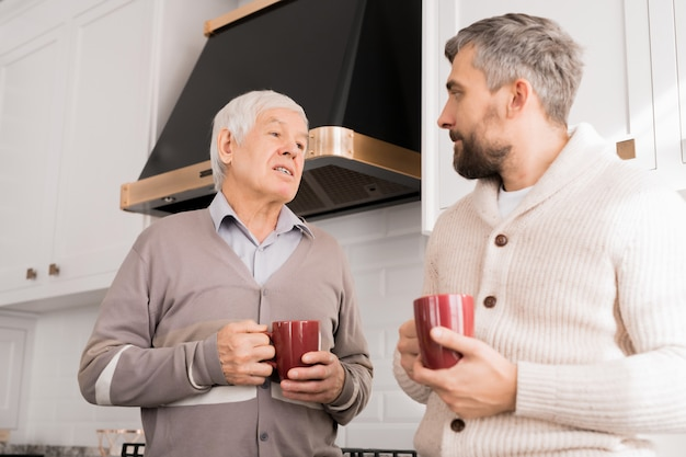 Senior father talking to adult son