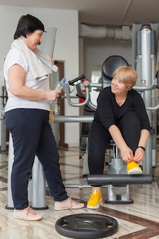 Senior female couple working out