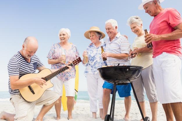 Senior friends having a barbecue