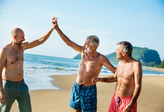 Senior friends having fun at the beach