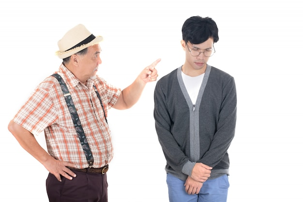 Senior furious father yelling at his son isolated on white background