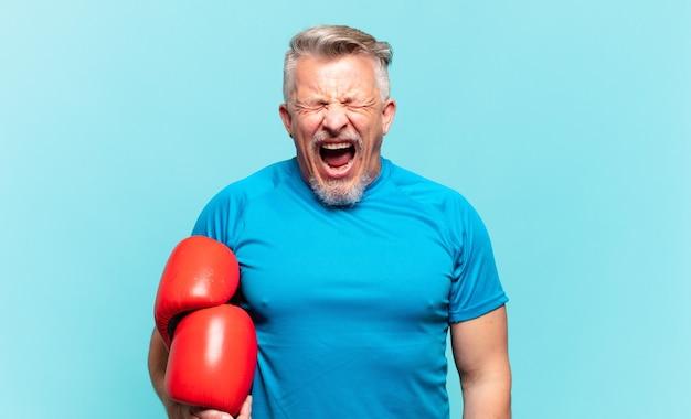 Senior handsome man boxing
