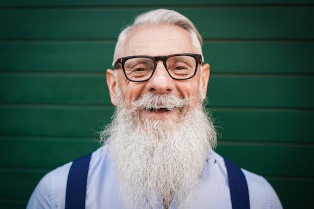 Senior hipster man smiling