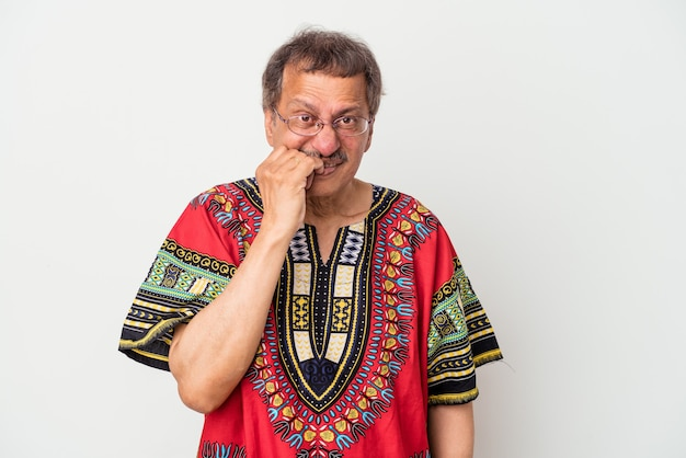 Senior indian man wearing a indian costume isolated on white background biting fingernails, nervous and very anxious.