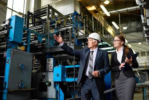 Senior inspector touring modern factory