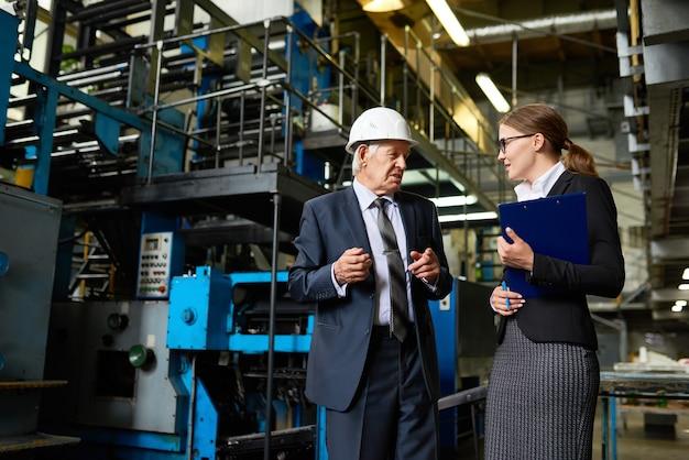 Senior investor visiting factory workshop