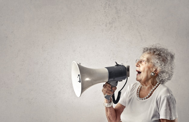 Senior lady talking into a megaphone