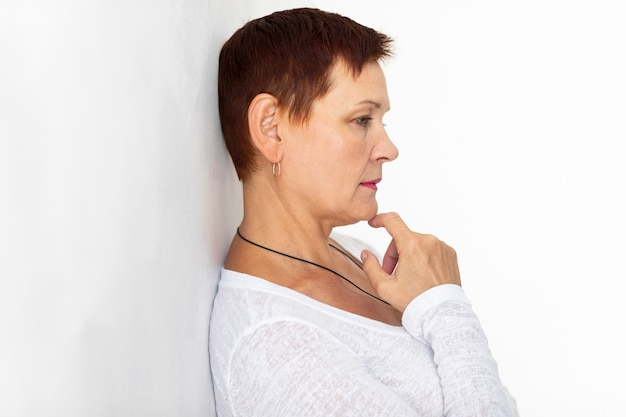Senior lady with short hair thinking
