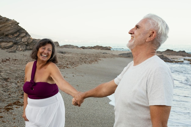 Senior loving couple spending time together at the beach
