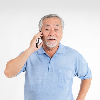 Senior male , old man using a smartphone , smiling feel happy on white background - lifestyle senior concept