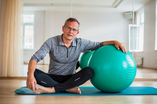 Senior male ready to use exercise ball